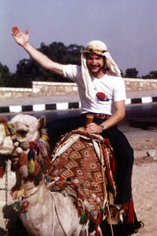 John enjoys his first camelid encounter, circa 1979