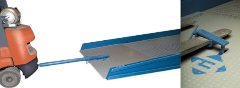 ramp clamp and tow bar allow a yard ramp to move with ease