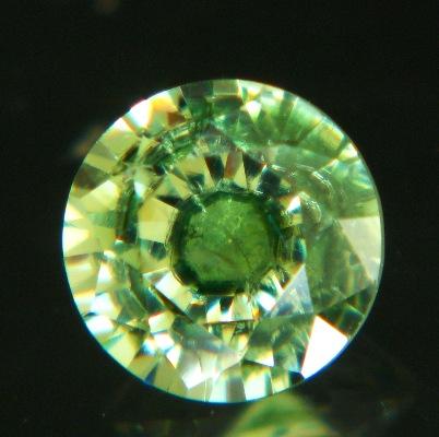 grass green demantoid in 5mm round diamond-killer
