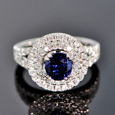 white gold and diamonds around a two carat unheated burma sapphire in royal blue