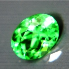 Precision cut unheated neon green Burma peridot in trillion and IGI report for bespoke jewelry