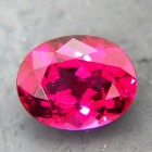 Tanzanian rhodolite garnet 1.41 carat, free of treatments, oval red purple in neon hue