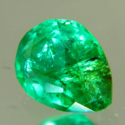 vivid green emerald pear half carat