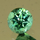 Neon blue green round Mozambique tourmaline