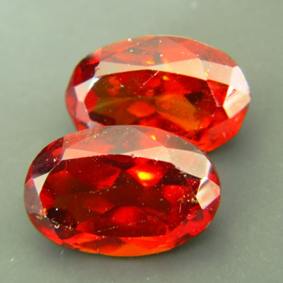untreated red garnets in oval pair near 16 carat