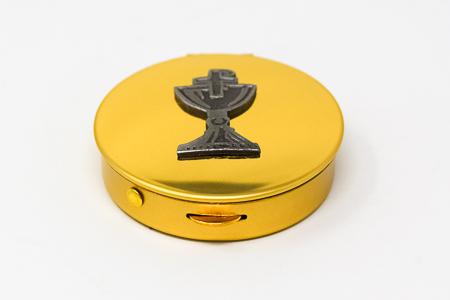 Bronze Pyx with Chalice Design.