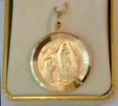 Virgin Mary Round 9 kt Medal .
